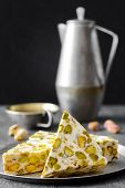 foto of phyllo dough  - eastern traditional dessert with nuts on gray background - JPG