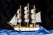 picture of mast  - Model white sailboat with three masts on a black background - JPG