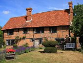 picture of english cottage garden  - Attractive traditional English period cottage of brick and timber construction complete with lavender flower garden - JPG
