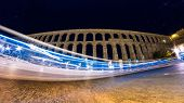 pic of aqueduct  - A bus drives through the shot of the famous Segovia Aqueduct - JPG