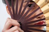 image of japanese woman  - Charming Japanese beauty with fan - JPG
