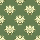 stock photo of tendril  - Foliate pattern in baroque style with seamless ornament of ornate beige leaves scrolls and curly tendrils on green background for wallpaper and tile design - JPG