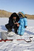 picture of grandpa  - 4 year old boy on winter fishing with grandpa  - JPG