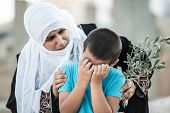 picture of arabic woman  - Arabic Muslim Middle Eastern woman with olive branch and son crying - JPG