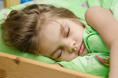 picture of 6 year old  - six year old girl Europeans sleeping in her bed - JPG