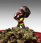 image of rastaman  - Rastaman figure is preaparing himself a joint - JPG