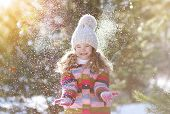 image of joy  - Joyful child having fun with snow in winter day - JPG