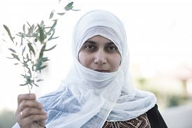 image of muslim  - Arabic Muslim Middle Eastern woman with olive branch as peace symbol - JPG