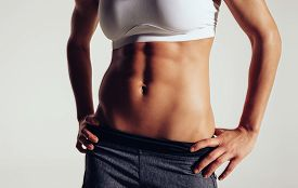 stock photo of slim model  - Slim and fit woman belly - JPG