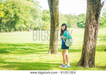 Woman In Park Outdoor With Knapsack