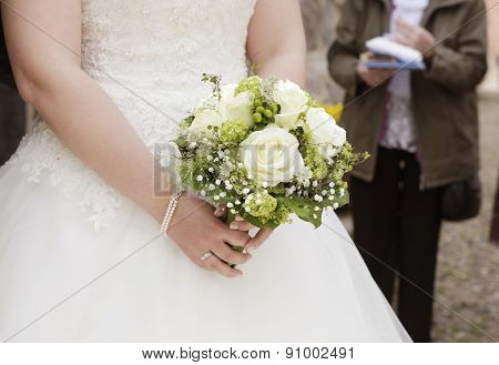 Bride With Bridal Bouquet In Her Hand