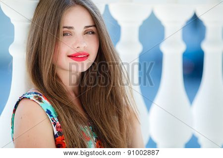 Young smiling woman portrait outdoors in the summer.