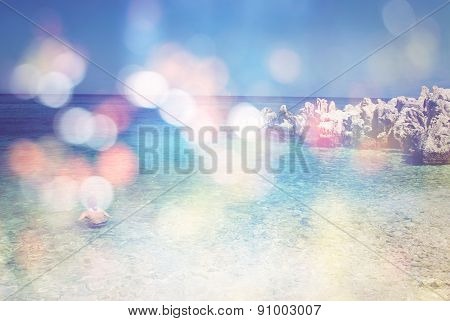 Background Of Blurred Beach And Sea Waves With Bokeh Lights, Sandy Beach With Turquoise Water, Brigh