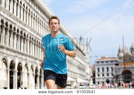 Running runner man jogging in Venice. Male sport athlete training on travel vacation as tourist on Piazza San Marco Square, Venice, Italy, Europe.