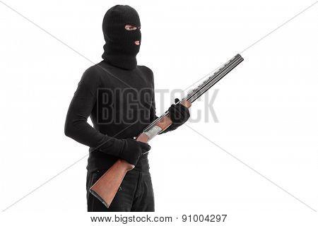 Dangerous criminal holding a shotgun rifle isolated on white background, studio shot