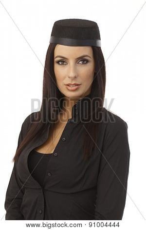 Portrait of attractive young stewardess looking at camera.