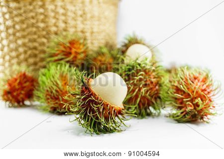 Clusters Of Fresh Rambutan With Basket In Background