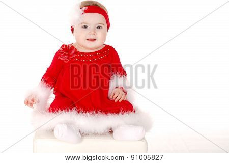 Holiday portrait of a little girl in a red dress.