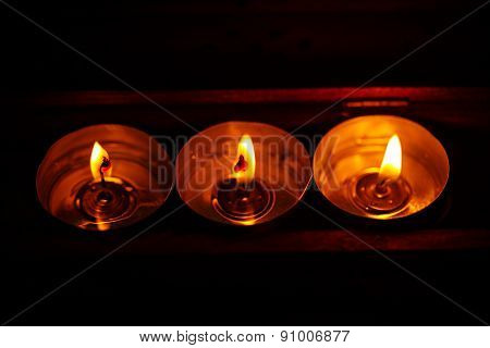 Burning Candles On Dark Background With Warm Light