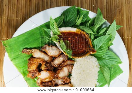 Dish Of Fried Pork And Sticky Rice