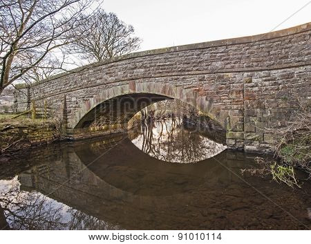 Old Stone Bridge Over A Stream