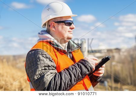 Engineer working with tablet PC at outdoors
