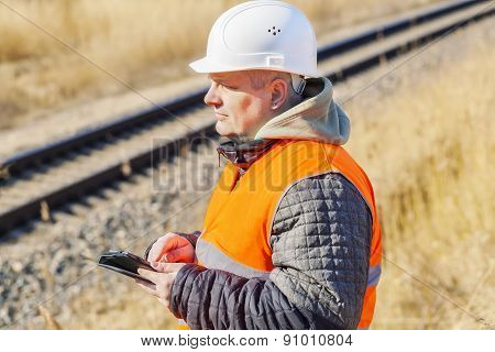 Railway Engineer with tablet PC near to railway