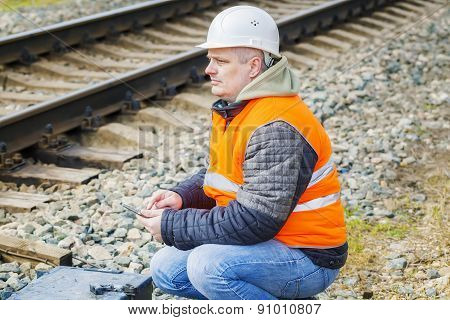 Railway Engineer working with tablet PC near railway