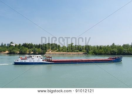 Transport by industrial boat on the river