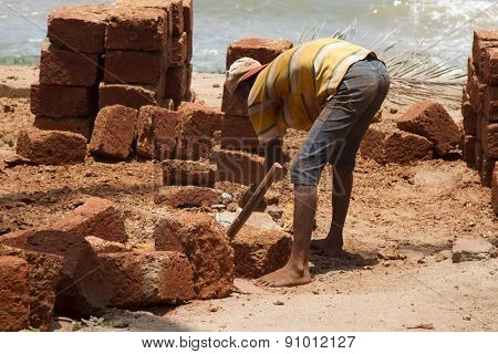 The Indian man works at building. India Goa.