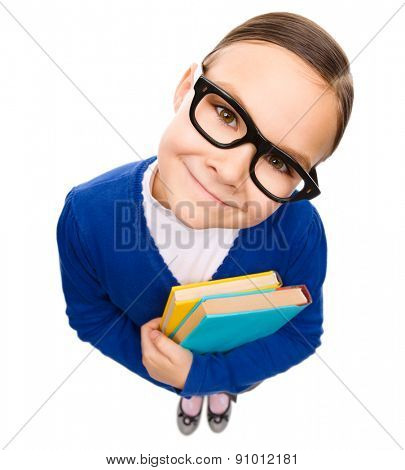 Funny little girl is holding books, fisheye portrait, isolated over white