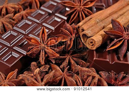 Chocolate, Star Anise And Cinnamon Sticks Close Up As