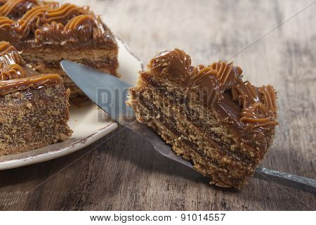 Piece Of Cake With Honey Shortcakes, Cream Boiled Condensed Milk On A Spoon Cake