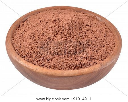 Cocoa Powder In A Wooden Bowl On A White