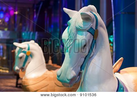 Two White Carousel Horses At Park