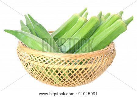 Okra fruit in bamboo basket
