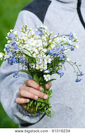 Holding bouquet of wild flowers