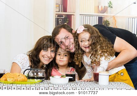 Portrait of attractive happy family with two little girls