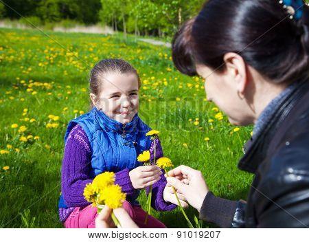Mother Weaves A Wreath Of Dandelions