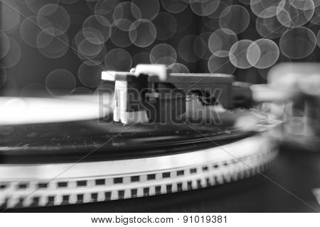 Gramophone with a vinyl record in shades of gray