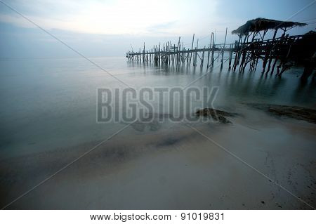 Traditional Wooden Bridge On The Beach.
