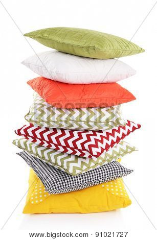 Stack of colorful pillows isolated on white