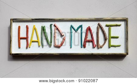 Sign With Colorful Wooden Letters Forming Word