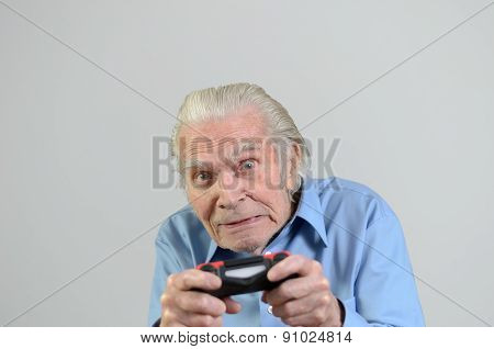 Funny Grandfather Playing A Video Game On Console