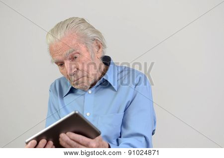 Elderly Man Holding A Modern Tablet Pc