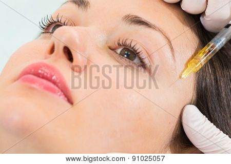 Subcutaneous injection into the girl's face
