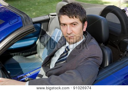 Portrait of young businessman in the car