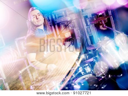 Man playing drums live. Concept live music.Double exposure