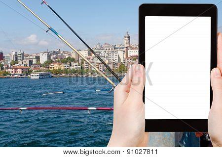 Tourist Photographs Galata Bridge In Istanbul