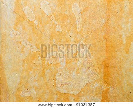 Cracked Hand Print on Wall orange background